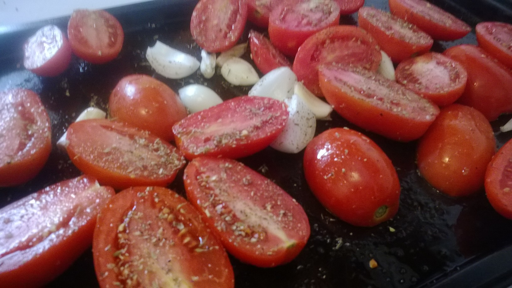 Tomatoes with onion, garlic, salt and pepper and crushed red pepper flakes