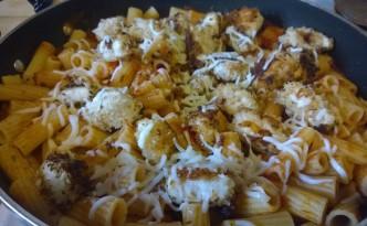 Parmesan chicken bites over pasta